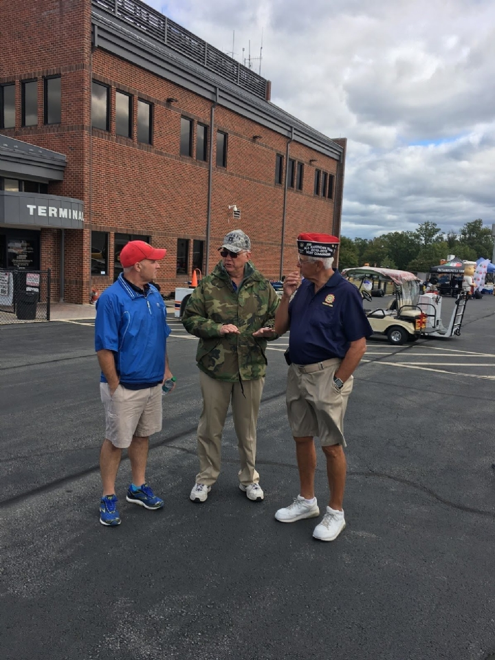 Comrades Dennis Boykin and Phil Rusciolelli meet with airshow officials at the show.