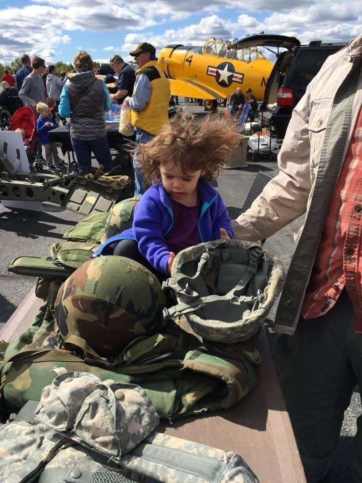 Despite the windy day, children enjoyed interacting with the military gear display and learning about the lives of our service-members.